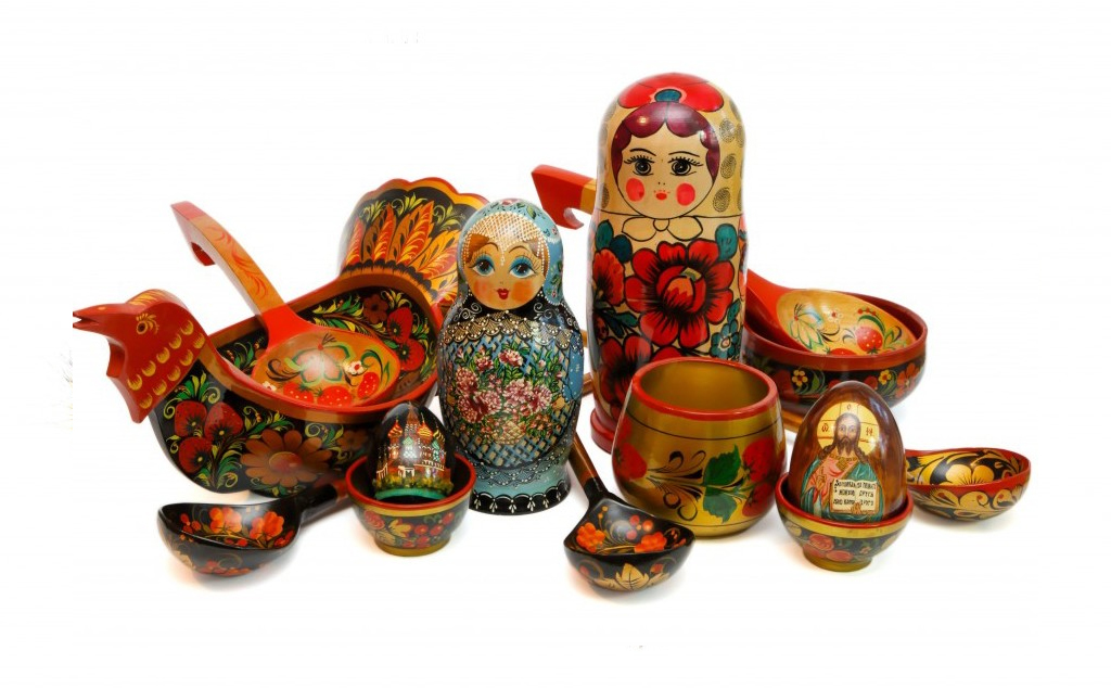 Assorted Russian wooden toys, kitchen utensils and religious objects